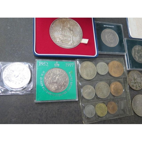 858 - A collection of British coinage including a silver, 2.8 troy, 25 year coronation medal