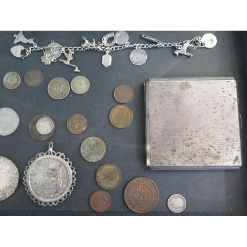 293 - Assorted coinage including a Thaler, a Luisitania German medal, a silver charm bracelet and a silver...