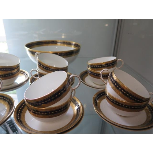 294 - A Royal Crown Derby blue and gilt dinner tea service with 12 cups and saucers, 12 tea plates, 6 side...