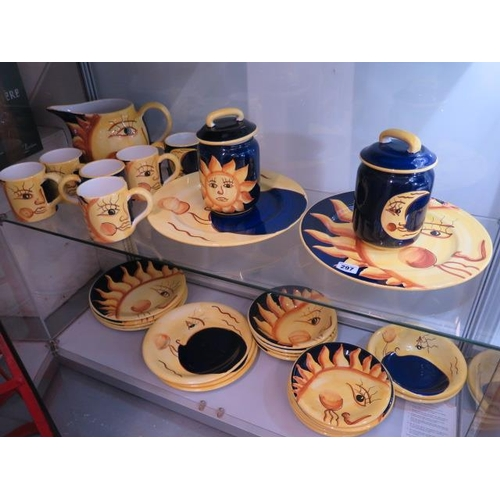 297 - An Italian Sun and Moon collection of tableware including 6 mugs, a jug, 2 platters, 7 dining plates...