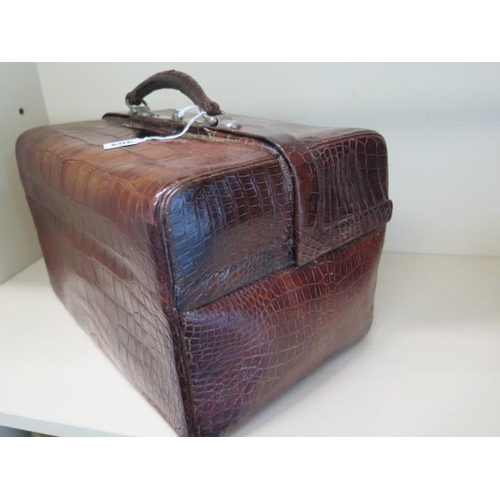 304 - A late Victorian / Edwardian crocodile Gladstone type case with a crocodile wallet and card case and...