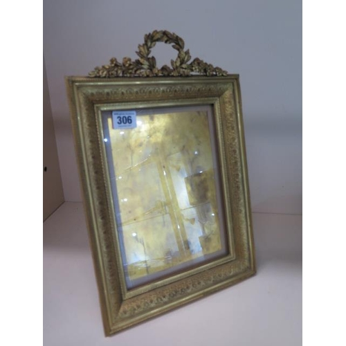306 - A good quality ormulu bronze easel back photograph frame, 37cm tall x 25cm wide, some small dents to...