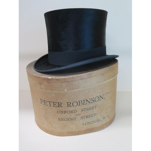 309 - A Christys of London black silk top hat with Peter Robinson box, size approx 7 1/2, measures 16cm ta...