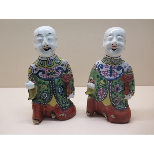 315 - A pair of Chinese 19th / early 20th century wall figures of laughing boys each holding a rui and oth...