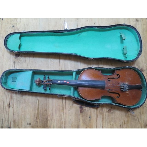"""A French halfsize violin with a two piece 12 1/4"""" back with label Lutherie Artistique M. COUTURIEUX, general wear to case but no obvious cracks in a later case"""