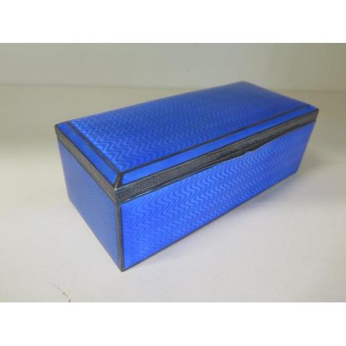 501 - A silver blue guilloche enamel desk box, import 925 mark London 1925/26 PHV, 6.5cm x 18cm x 8cm, tot...