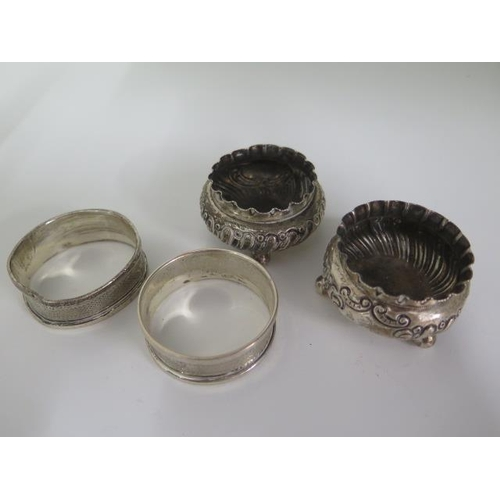 504 - A pair of silver salts and a pair of silver napkin rings, some denting to all, approx 1.6 troy oz