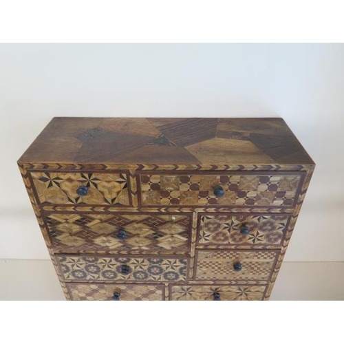 51 - An Oriental parquetry inlaid eight drawer jewellery / collectors chest, 45cm tall x 45cm x 17cm, in ...