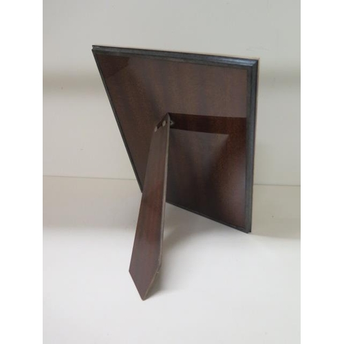 514 - A silver presentation photo frame with mahogany easel back, 28cm x 21cm, in good condition