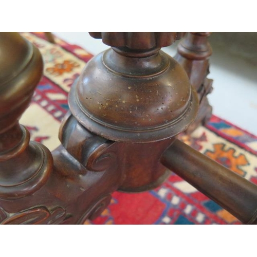 52 - A Victorian inlaid stretcher table on turned pillar supports, 70cm tall x 99cm x 55cm, some losses a...