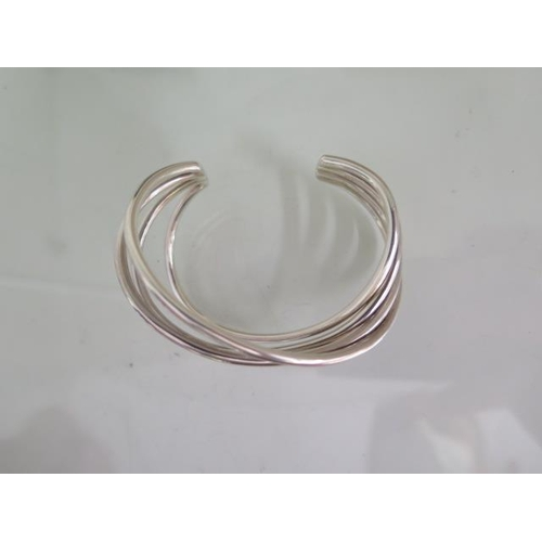 602 - A Georg Jensen sterling silver Alliance bangle, 7.5cm wide external, boxed and in good condition, ap...