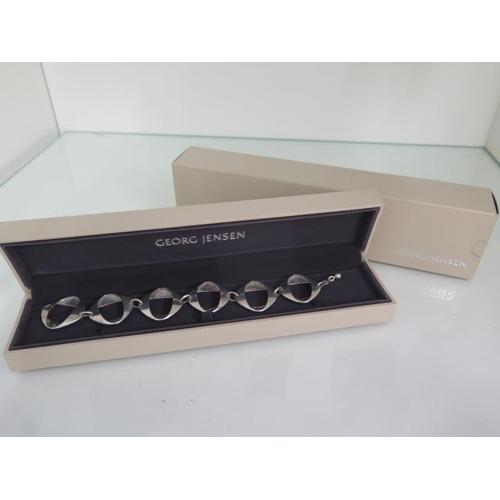 605 - A Georg Jensen sterling silver bracelet designed by Henning Koppel, number 190, 21cm long x 3cm wide...