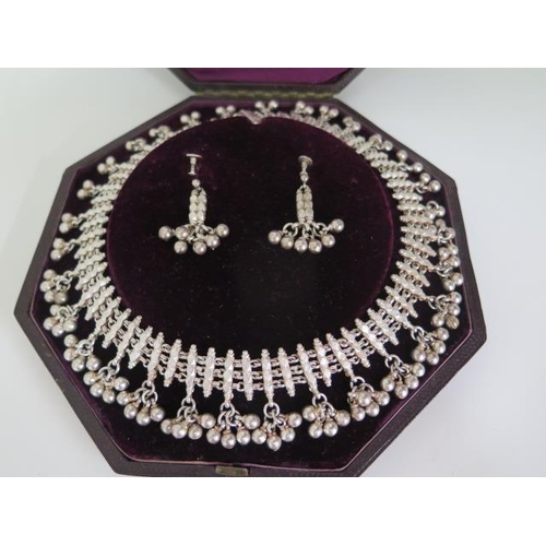606 - An Indo-Persian design white metal silver necklace earring set retailed by Hunt & Roskell late Storr...