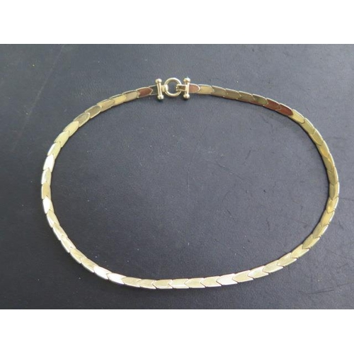 617 - A 14ct yellow gold necklace marked 14KT ITALY, 45cm long, approx 28 grams, set with small stones to ...