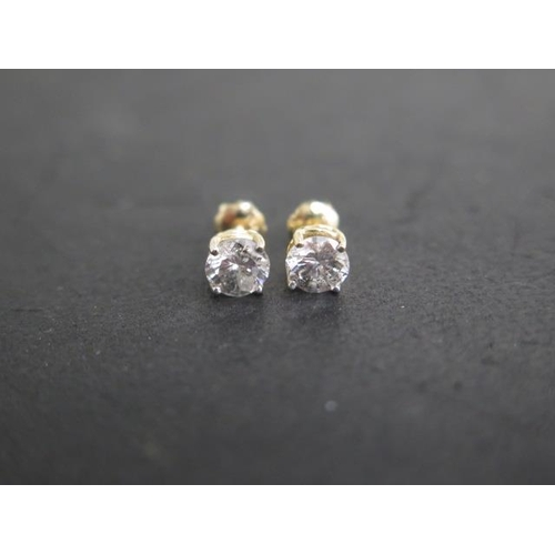 618 - A pair of 14ct yellow gold diamond earrings total estimated 1.16ct, marked 14K, with screw stud back...