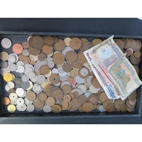 A collection of assorted World banknotes and coins