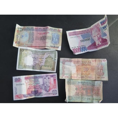 852 - A collection of assorted World banknotes and coins