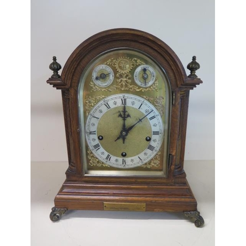 154 - A good quality oak presentation chiming mantle clock, chiming on five gongs, movement stamped W & H ...
