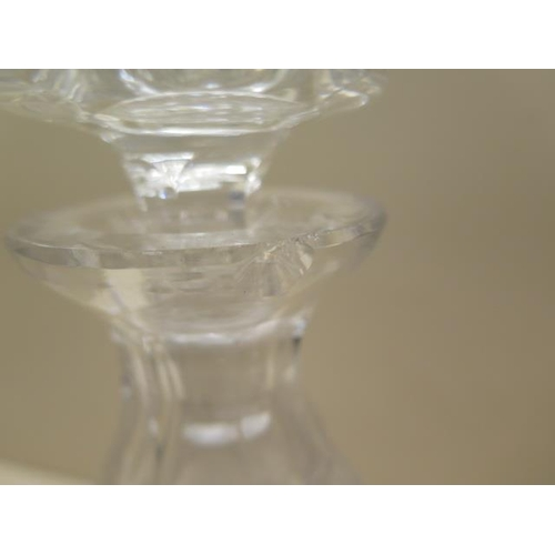 304 - A pair of good quality cut glass decanters, 25cm tall, one has a small chip to rim and small chips t...