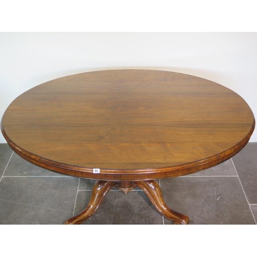 51 - A good 19th century rosewood breakfast table with an oval 152cm x 120cm top on a carved quatrefoil s...
