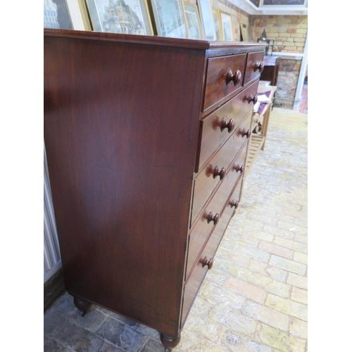 53 - An early Victorian mahogany two over four chest of graduated drawers, the drawers with their origina...