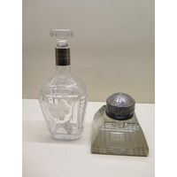 An engraved presentation decanter with Swedish silver collar, 24cm tall, and a large glass inkwell with plated top, 12cm wide, both generally good some scratching to inkwell base and wear to plate
