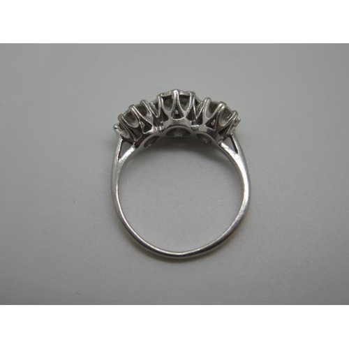 601 - A hallmarked 18ct white gold three stone diamond ring, the outer diamonds approx 0.55ct each, the ce...