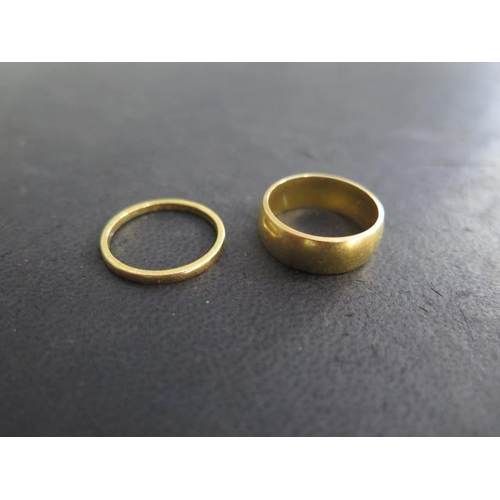 609 - Two hallmarked 22ct yellow gold rings, sizes K, approx 7.8 grams