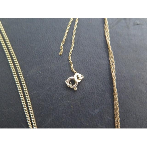 610 - A 9ct yellow gold St Christopher on a 60cm chain and a 9ct pearl pendant on a 42cm chain, ring broke...