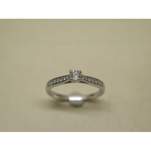 614 - A Forever diamond 950 hallmarked platinum solitaire ring, size Q, the centre stone approx 0.21ct, co...