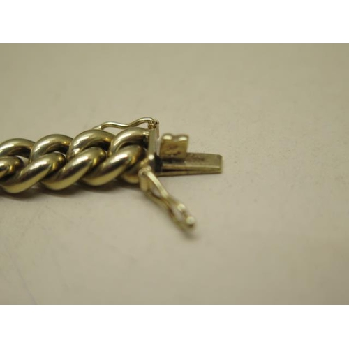618 - A 14ct yellow gold solid curb pattern bracelet, approx weight 38.9 grams, length 20cm x 7mm wide, fi...