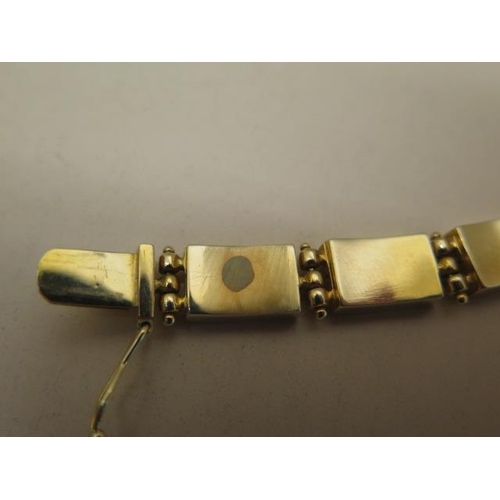619 - A 14ct gold ladies bracelet, total weight approx 28.8 grams, length 19cm x 8mm wide, fitted with an ...