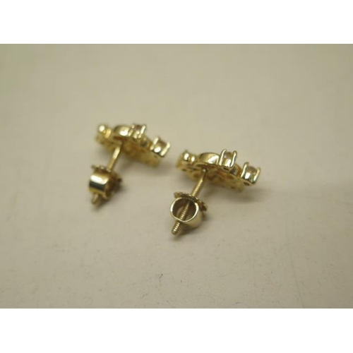 625 - A pair of matching 18ct earrings, total weight approx 4.3 grams, fitted with threaded post and scrol...