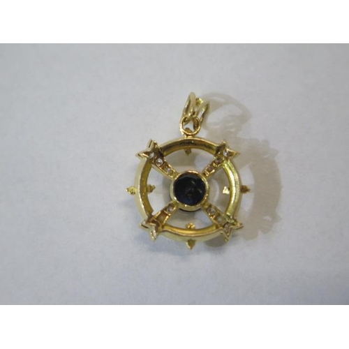 629 - A 18ct yellow pendant, size approx 25mm x 18mm, incorporating a single round dark blue sapphire, app...