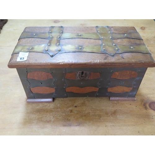 63 - An oak brass bound box with iron carry handles, 23cm tall x 49cm x 25cm