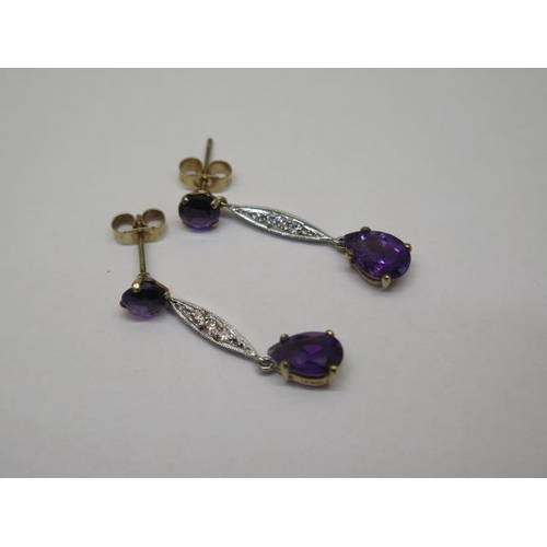 630 - A pair of 9ct yellow and white gold amethyst and diamond earrings, 3cm drop, approx 2.4 grams, in go...