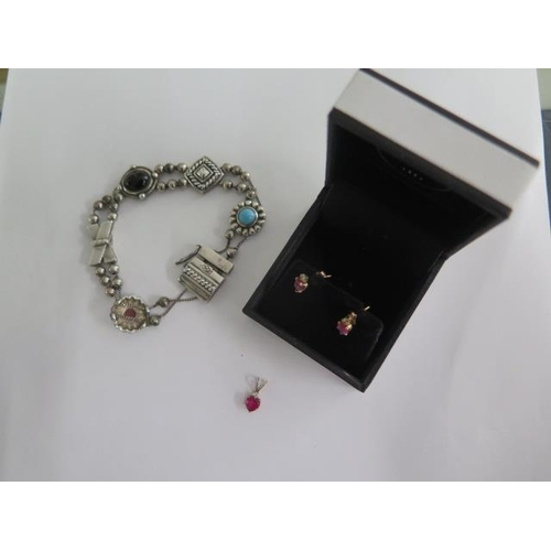 633 - A 10K gold pendant and earring set, approx 0.7 grams and a silver charm bracelet, approx 18.8 grams