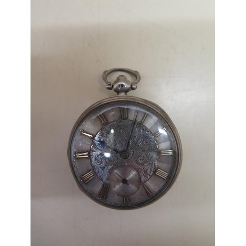 808 - A silver cased pocket watch with a 5cm case, some wear to case and dial, running order, with key