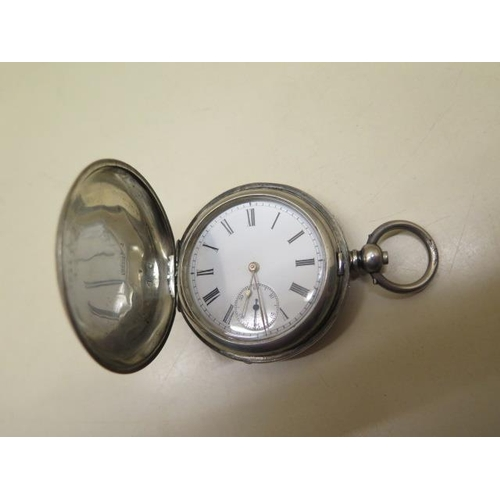 809 - A silver cased Dent & Sons hunter pocket watch, 5cm case, in running order, some wear / dents to cas...