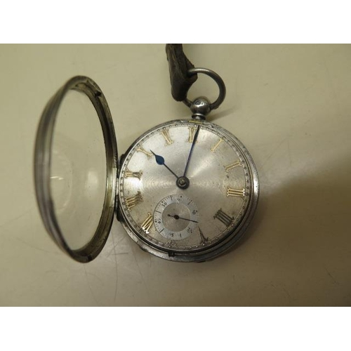 811 - A silver pocket watch with silver dial, 4.6cm case, running order, some scratches to dial, with key