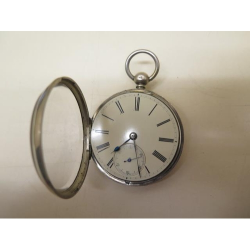 812 - A silver pocket watch with 5.2cm case in running order, generally good some wear to case, with key