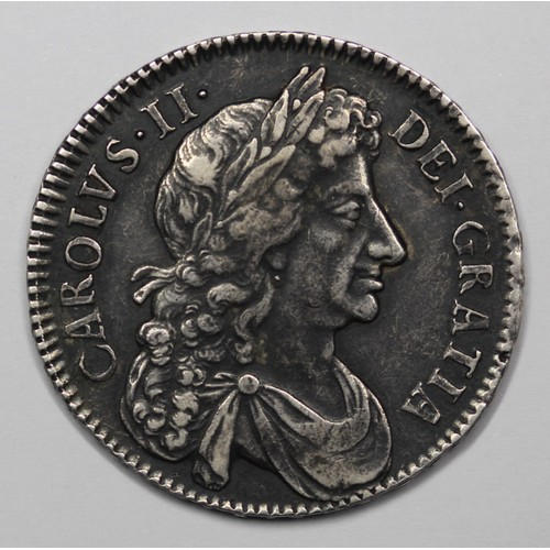 1676 Half Crown, Charles II. Edge Vicesimo Octavo. ESC 478, Bull 471 (Standard Date (Scarce)). gVF or better with adjustment marks at date. A strong bust not often seen on coins of this era. Dark toning providing a lovely backdrop to the details. An extremely handsome example.