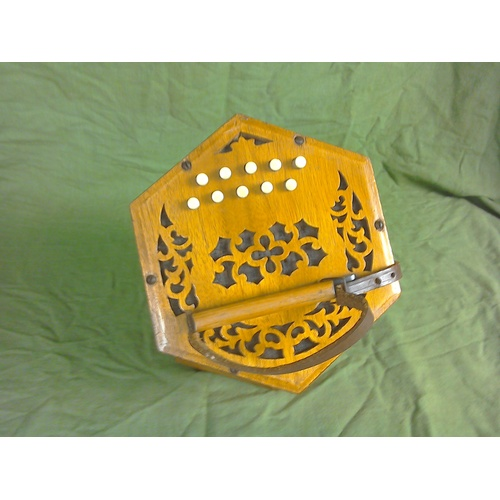 106 - A German made concertina, with box, 20 key, five fold, steel notes...