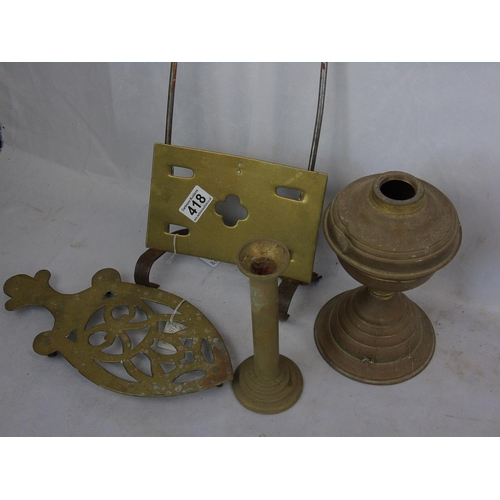 146 - Four items of brassware - trivets, candlestick etc...