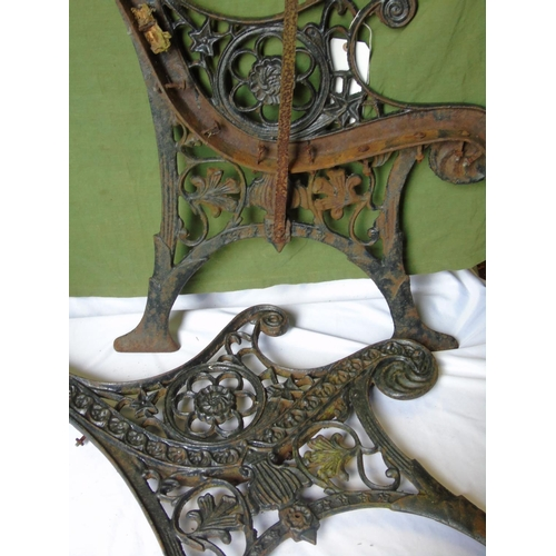 12 - Two cast metal decorative garden bench ends...