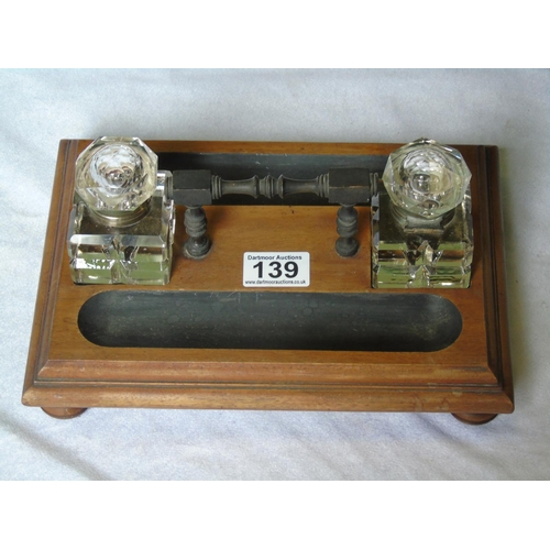 139 - Antique wooden inkstand with two glass inkwells...
