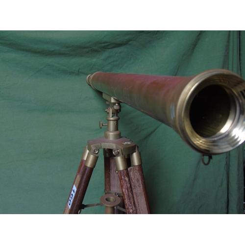 160 - A brass extending telescope and tripod stand...