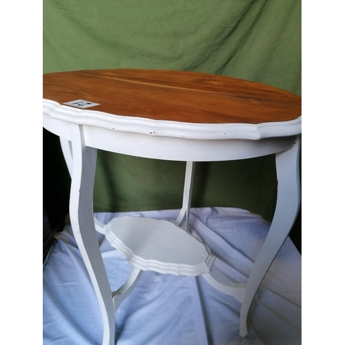 21 - An oval conservatory/hall table with painted base, H71, L71cm...