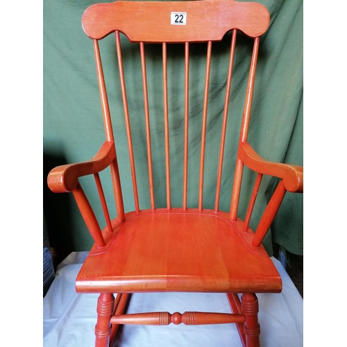 22 - A modern stick back beechwood rocking chair, colourstained...