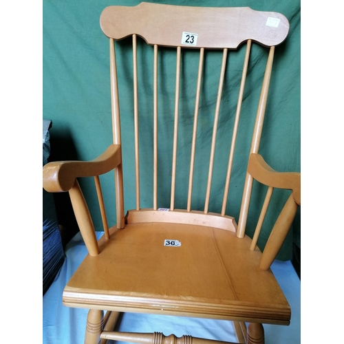 23 - Another modern beechwood stick back rocking chair, good condition...